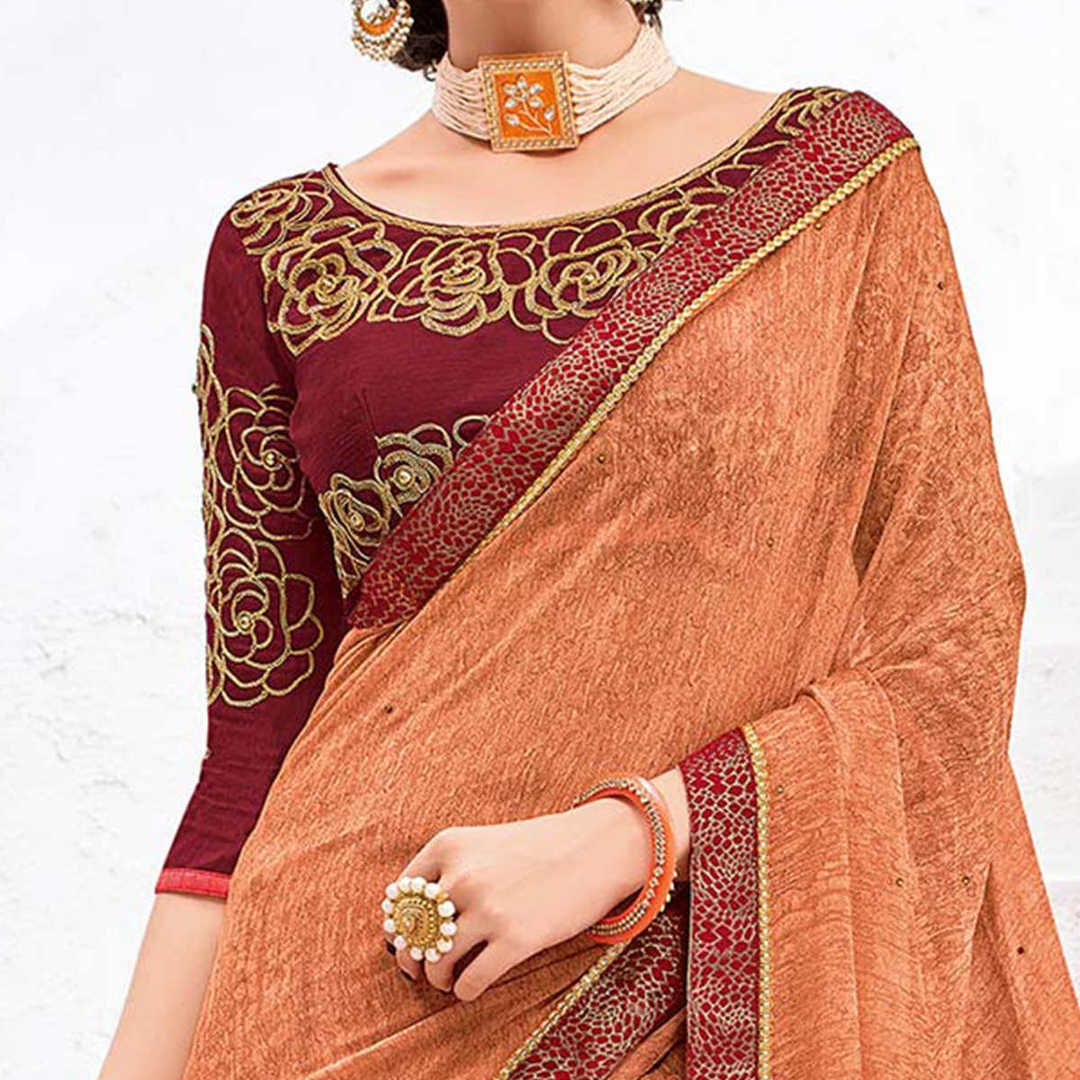 Lovely Orange Colored Designer Printed And Embroidered Partywear Georgette Saree