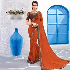 Charming Orange Colored Designer Printed And Embroidered Partywear Georgette Saree