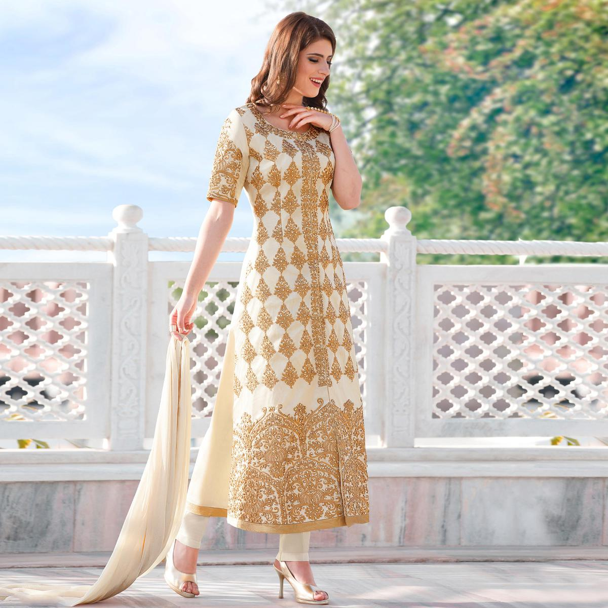 Elegant Off-White Colored Designer Embroidered Partywear Cotton Salwar Suit