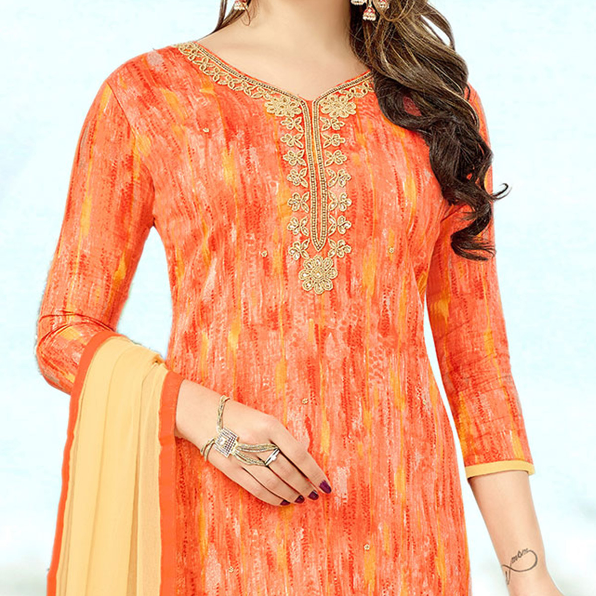 Ravising Orange Colored Designer Print With Bead And Stone Worked Cotton Dress Material