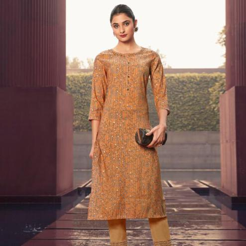 Entrancing Orange Colored Casual Wear Printed Muslin Kurti