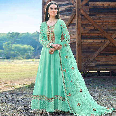 Elegant Turquoise Coloured Embroidered Partywear Semi Stitched Dola Silk Anarkali Suit