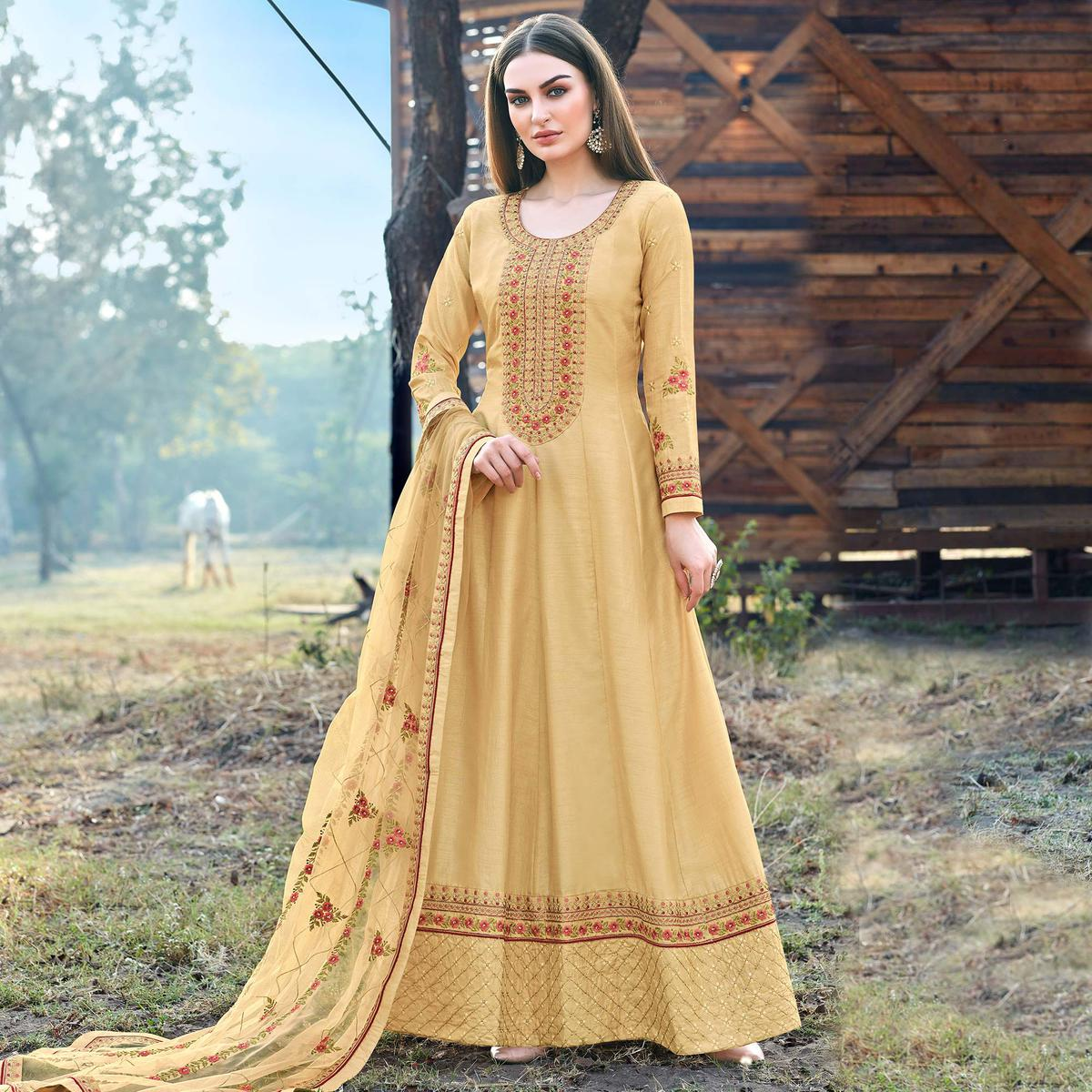 Energetic Yellow Coloured Embroidered Partywear Semi Stitched Dola Silk Anarkali Suit