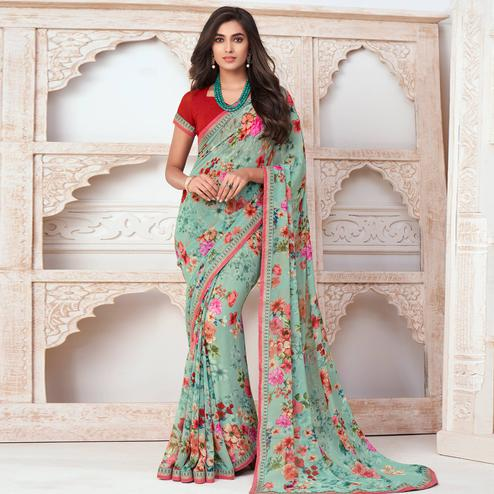 Charming Sea Green Colored Casual Wear Floral Printed Pure Georgette Saree
