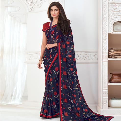 Adorable Navy Blue Colored Casual Wear Floral Printed Pure Georgette Saree