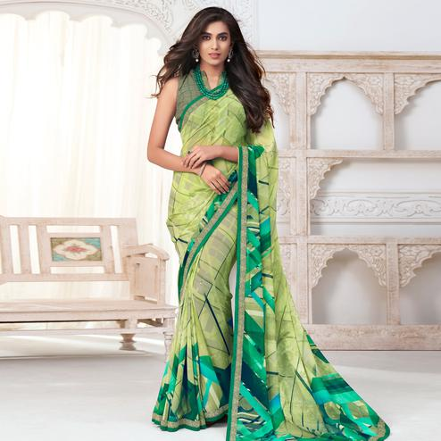Beautiful Light Green Colored Casual Wear Printed Pure Georgette Saree
