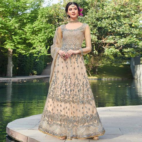 Sensational Cream Coloured Embroidered Net Partywear Semi Stitched Gown