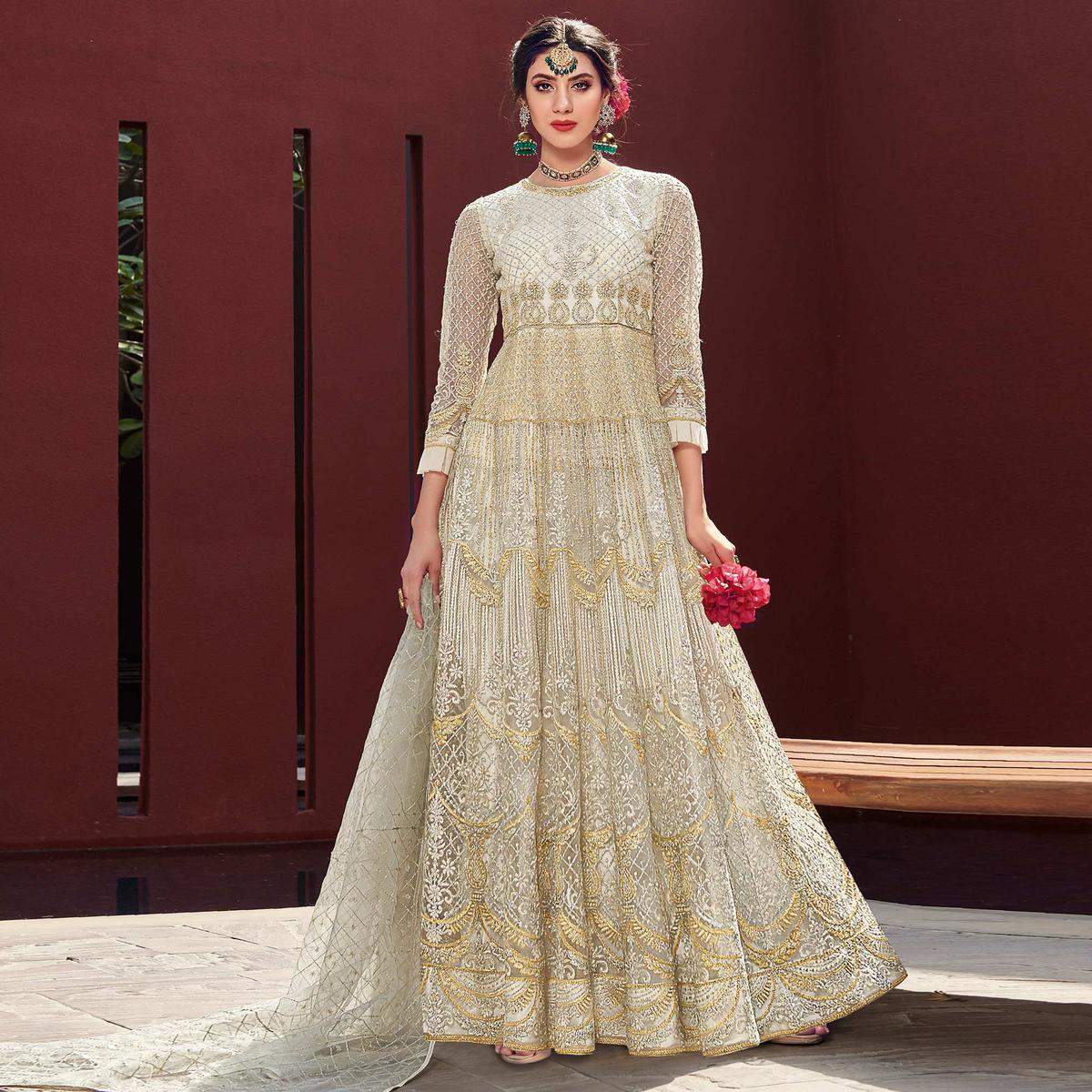 Ravishing Cream Coloured Embroidered Net Partywear Semi Stitched Gown