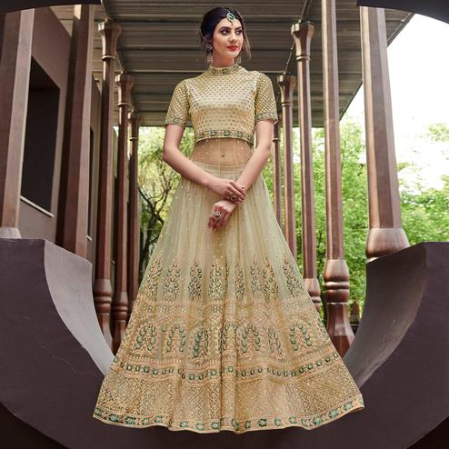 Alluring Beige Coloured Embroidered Net Partywear Semi Stitched Gown