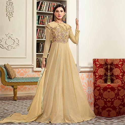 Elegant Cream Colored Designer Embroidered Net Anarkali Suit