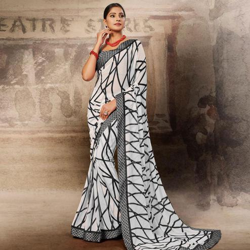 Eye-catching White-Black Coloured Printed Casual Wear Georgette Saree