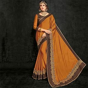Graceful Orange Partywear Georgette Saree
