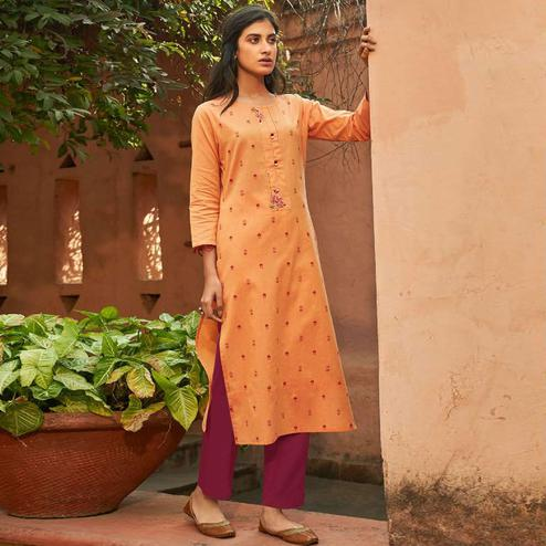 Lovely Orange Colored Casual Wear Embroidered Cotton Kurti With Bottom