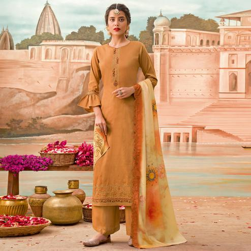 Prominent Orange Colored Partywear Embroidered Jam Silk Suit