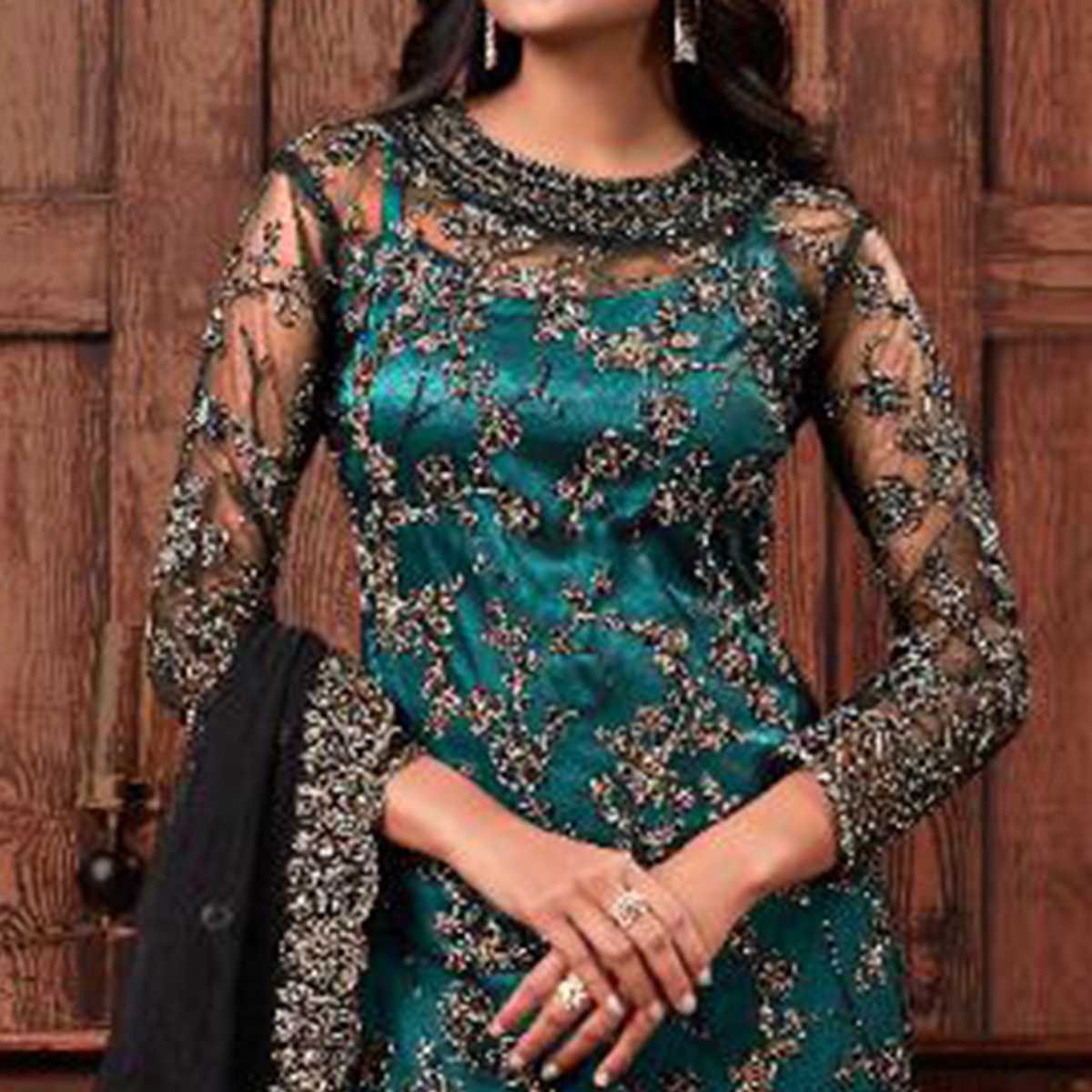 Pleasant Rama Black Coloured Embroidered Partywear Net Suit