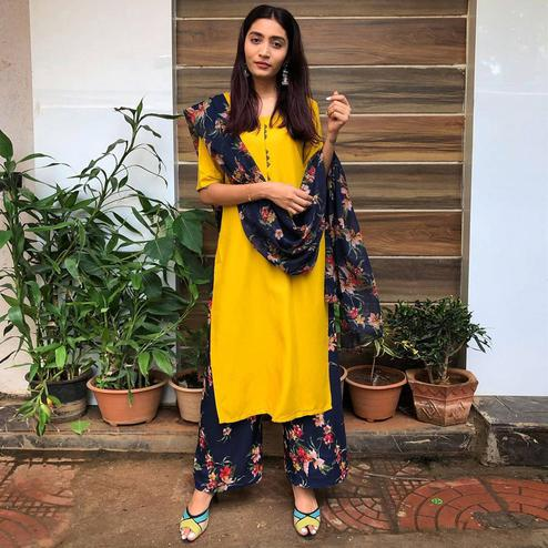 Amazing Yellow Colored Casual Wear Heavy Rayon Suit