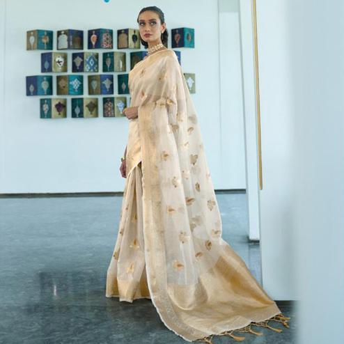 Trendy Beige Coloured Partywear Tissue Zari Organza weaving Saree