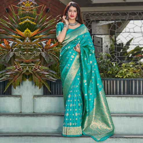 Staring Turquoise Coloured Partywear Woven Silk Saree