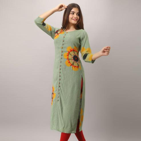 Prominent Green Colored Casual Wear Embroidered Muslin Kurti