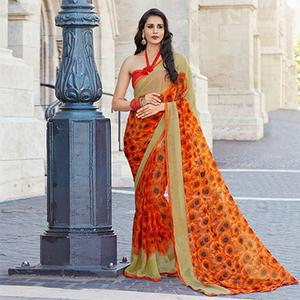 Attractive Orange Colored Casual Printed Weightless Georgette Saree