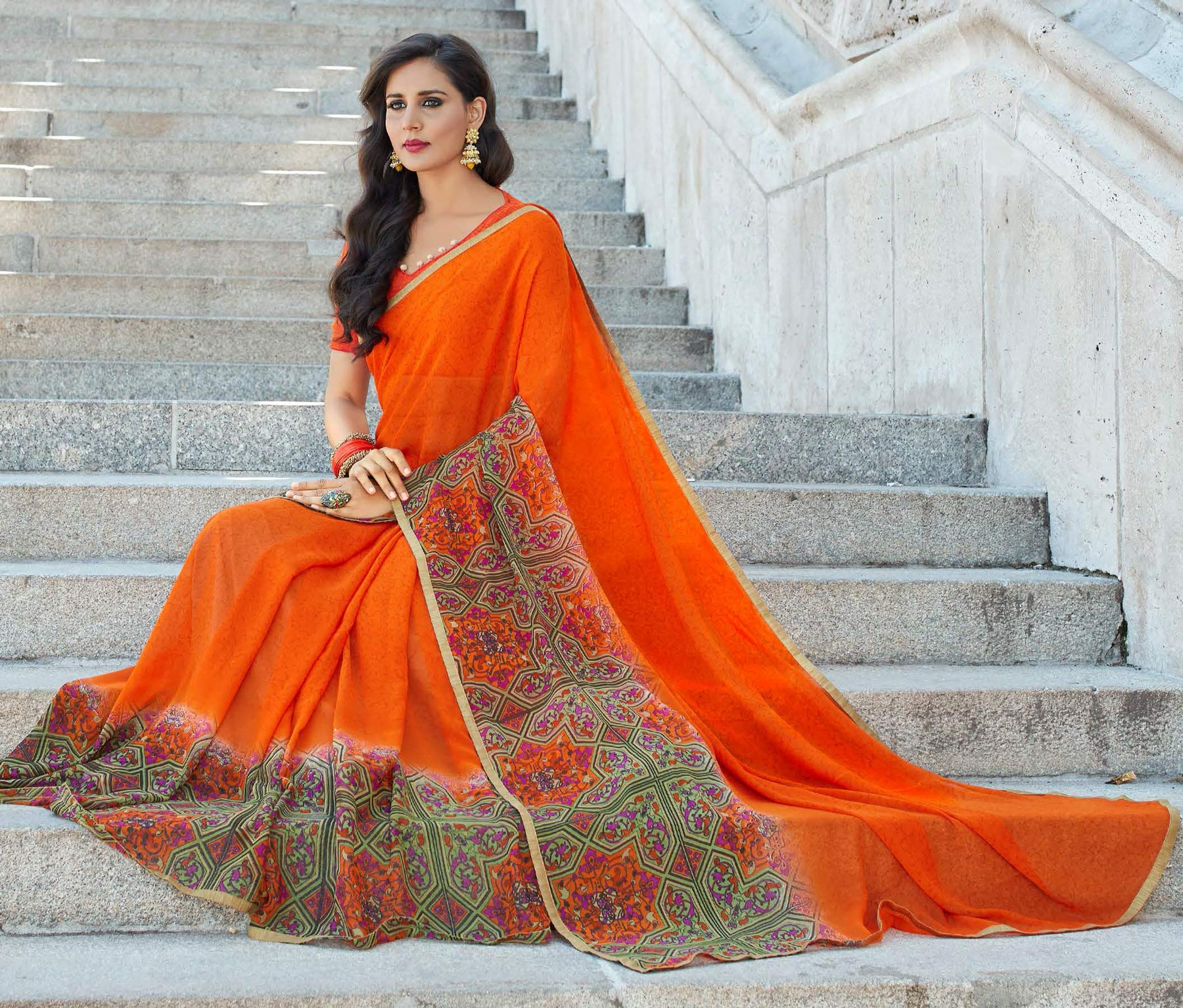 Gorgeous Orange Colored Casual Printed Weightless Georgette Saree