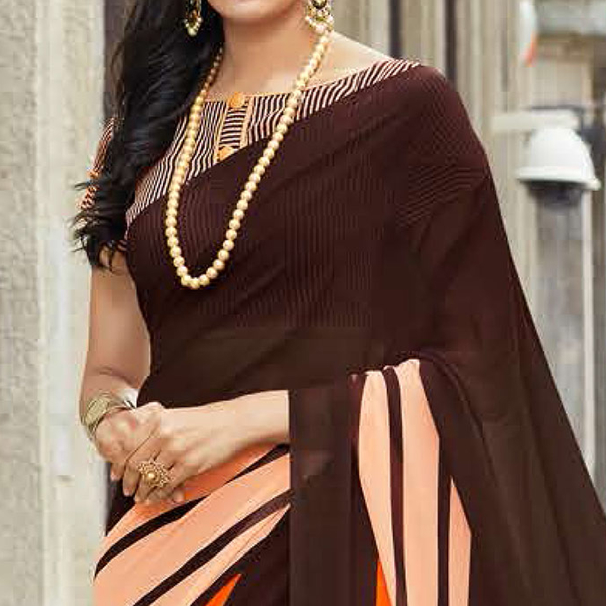 Gorgeous Brown Colored Casual Printed Weightless Georgette Saree