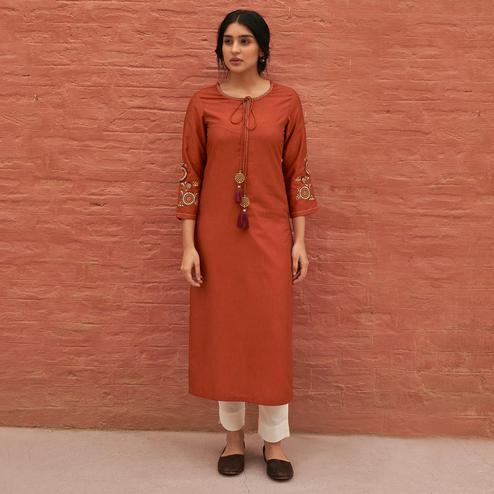Captivating Rust Orange Colored Partywear Embroidered Pure Viscose Kurti
