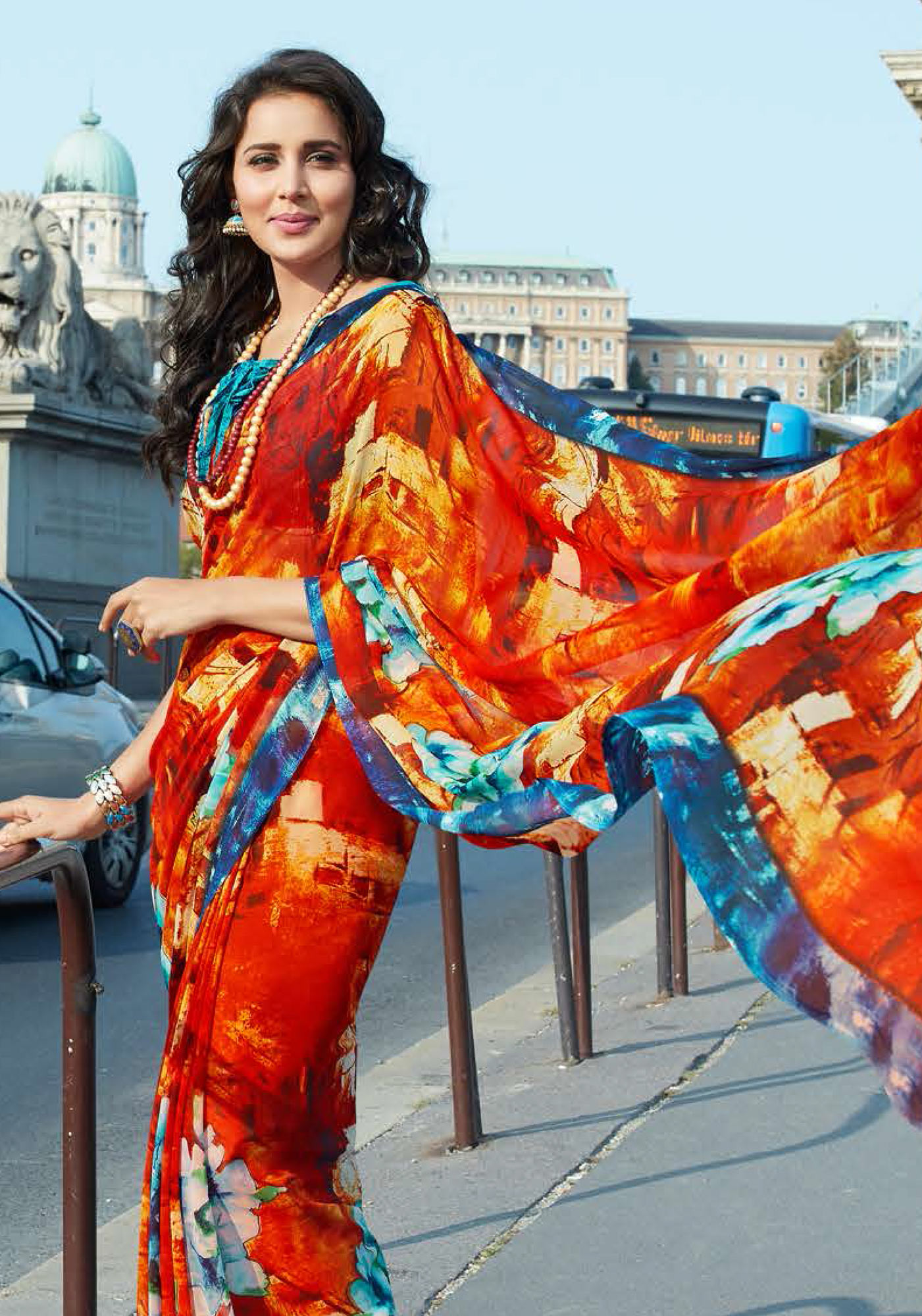 Sizzling Orange-Blue Colored Casual Printed Weightless Georgette Saree