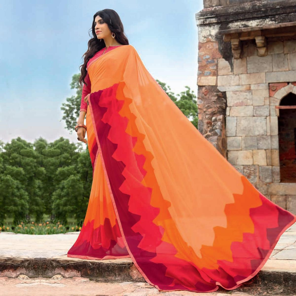 Sizzling Orange Colored Casual Printed Weightless Georgette Saree