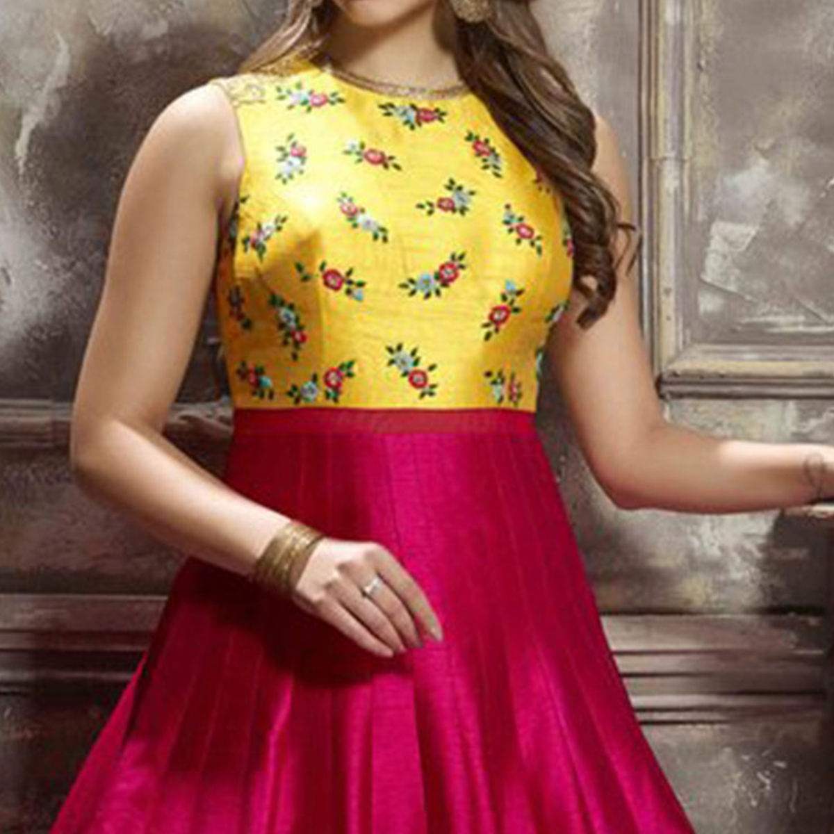 Graceful Pink And Yellow Designer Partywear Hand Embroidered Banglori Silk Gown
