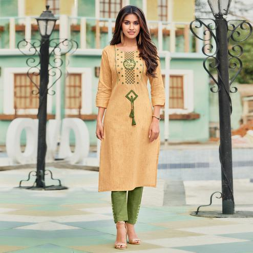 Capricious Yellowish Beige Colored Casual Wear Embroidered Heavy Pure Cotton Kurti