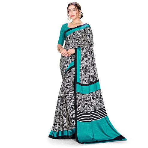 Lovely Blue-Black Colored Festive Wear Printed Satin Crepe Saree