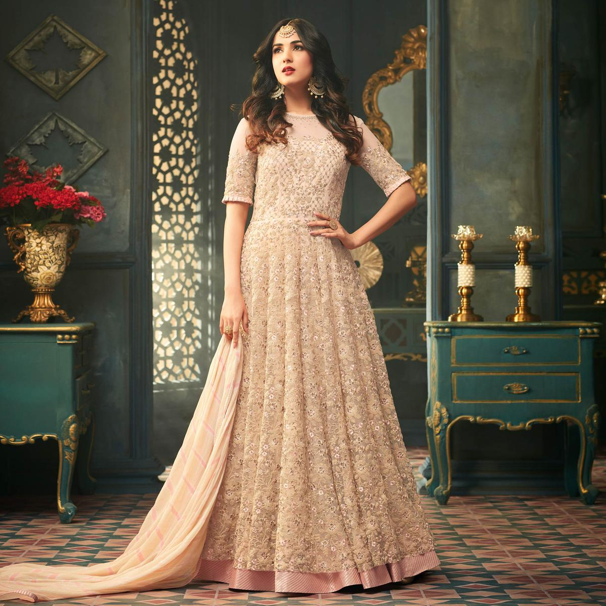 Lovely Cream Heavy Embroidered Wedding Wear Net Anarkali