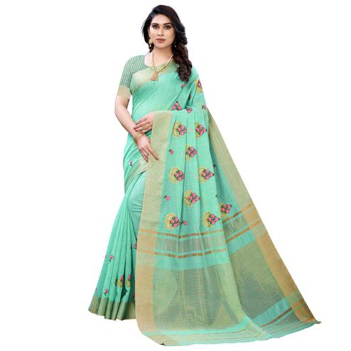 Blooming Turquoise Green Colored Festive Wear Embroidered Soft Linen Saree