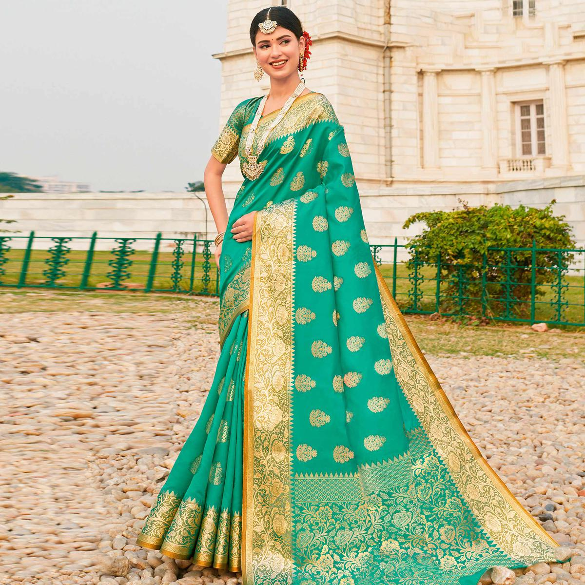 Flaunt Turquoise Green Colored Festive Wear Woven Silk Sareee
