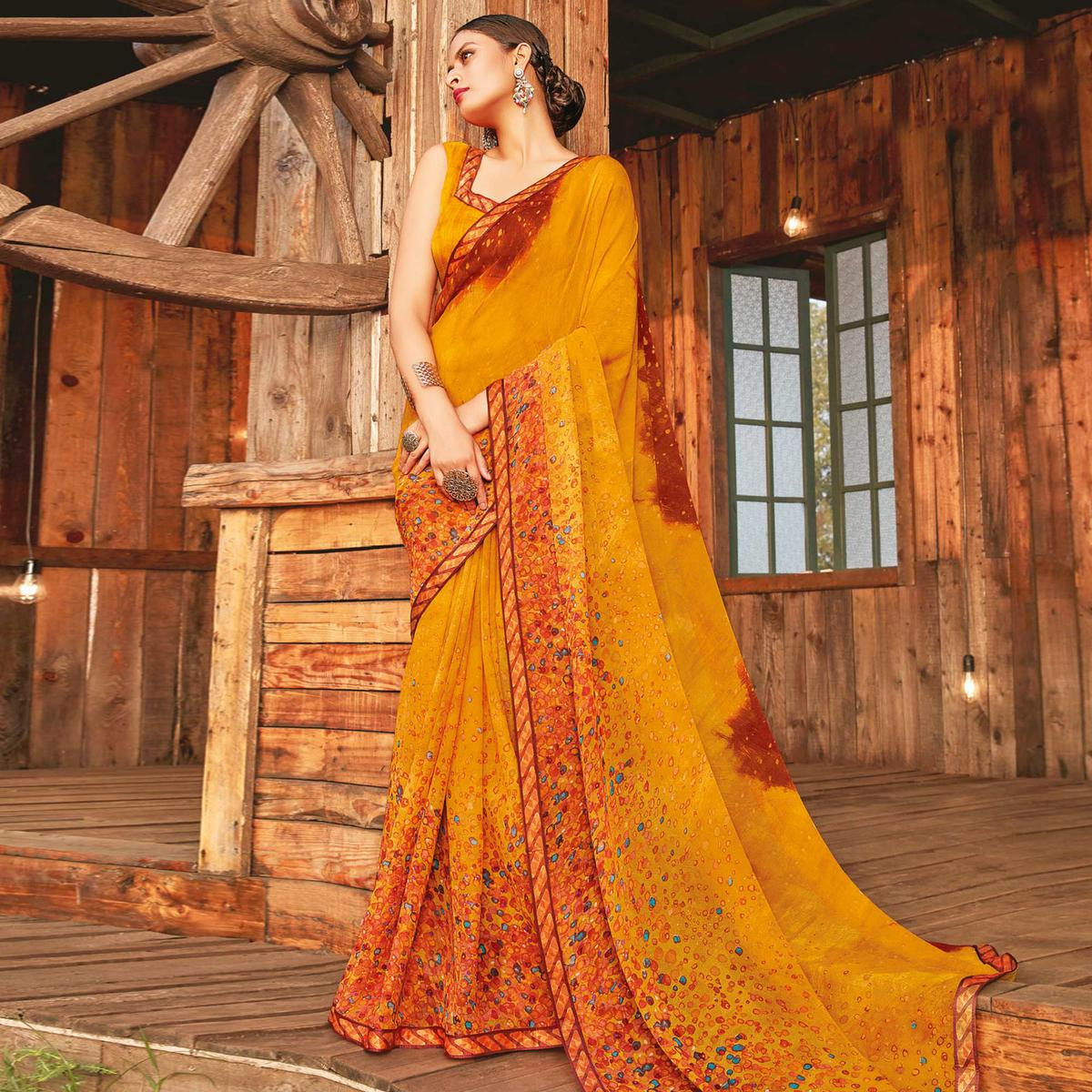 Adorable Mustard Coloured Partywear Pure Georgette Floral Printed Saree With Fancy Lace Border