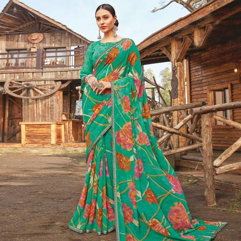 Graceful Rama Green Coloured Partywear Pure Georgette Floral Printed Saree With Fancy Lace Border