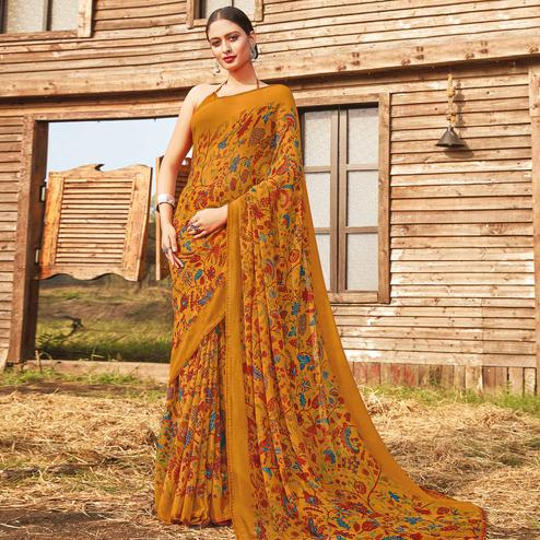 Charming Mustard Coloured Partywear Pure Georgette Floral Printed Saree With Fancy Lace Border