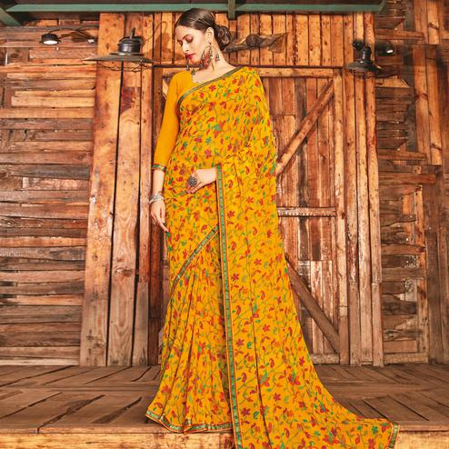 Jazzy Yellow Coloured Partywear Pure Georgette Floral Printed Saree With Fancy Lace Border