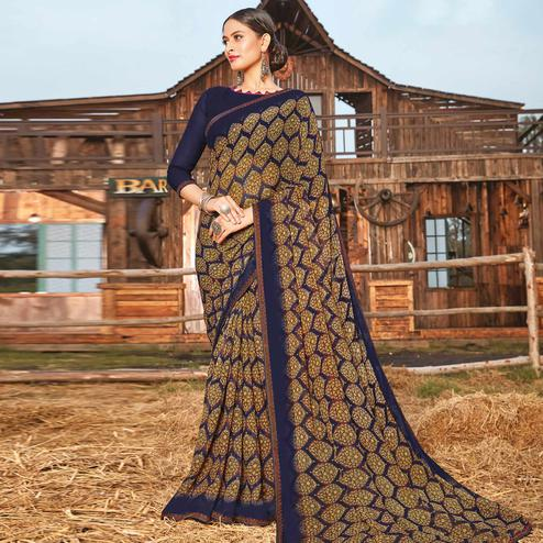 Ravishing Navy Blue Coloured Partywear Pure Georgette Floral Printed Saree With Fancy Lace Border