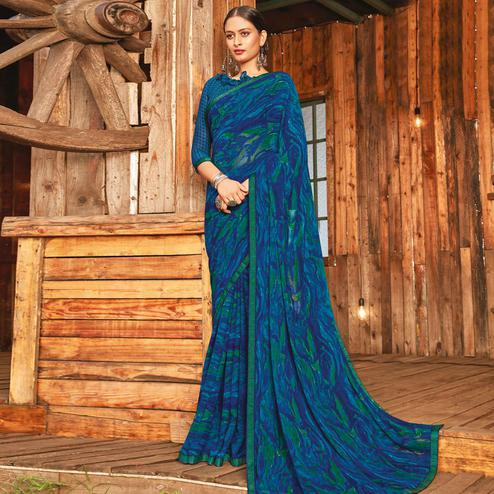 Captivating Rama & Blue Coloured Partywear Pure Georgette Floral Printed Saree With Fancy Lace Border