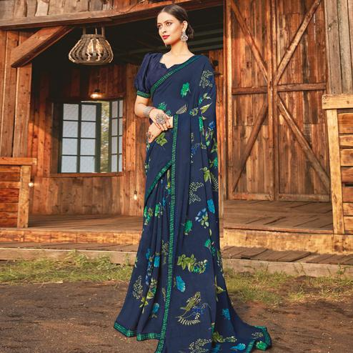 Innovative Navy Blue Coloured Partywear Pure Georgette Floral Printed Saree With Fancy Lace Border
