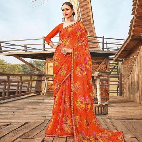 Eye-catching Orange Coloured Partywear Pure Georgette Floral Printed Saree With Fancy Lace Border