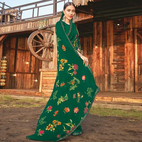 Ideal Bottle Green Coloured Partywear Pure Georgette Floral Printed Saree With Fancy Lace Border