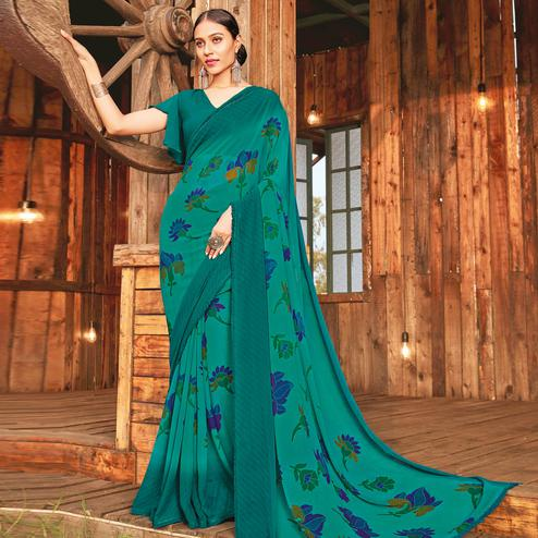 Adorable Rama Green Coloured Partywear Pure Georgette Floral Printed Saree With Fancy Lace Border