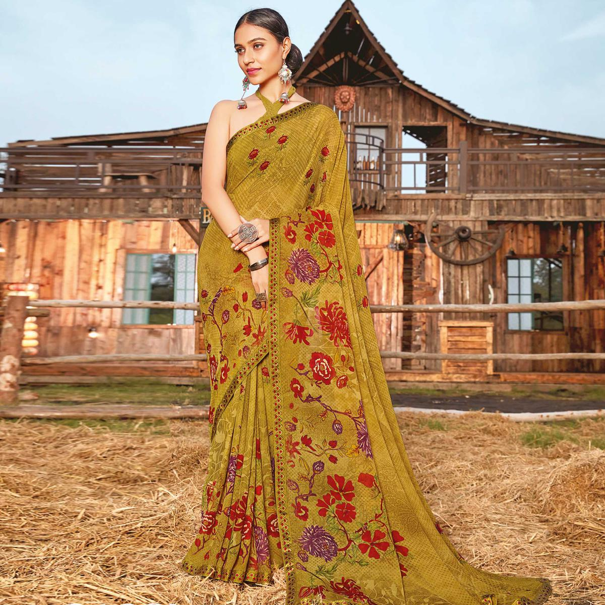 Pleasance Chikoo Coloured Partywear Pure Georgette Floral Printed Saree With Fancy Lace Border