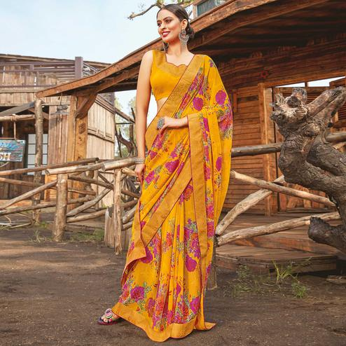 Ethnic Yellow Coloured Partywear Pure Georgette Floral Printed Saree With Fancy Lace Border