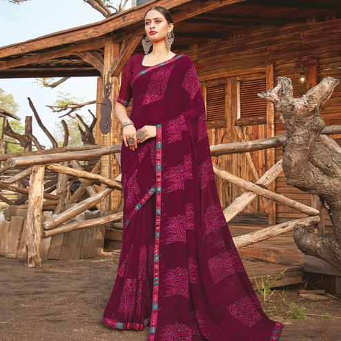 Staring Wine Coloured Partywear Pure Georgette Floral Printed Saree With Fancy Lace Border