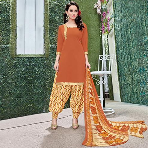 Flamboyant Orange Colored Casual Wear Printed Heavy Crape Patiala Dress Material