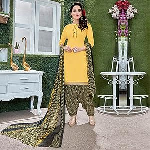 Ravishing Yellow Colored Casual Wear Printed Heavy Crape Patiyala Dress Material